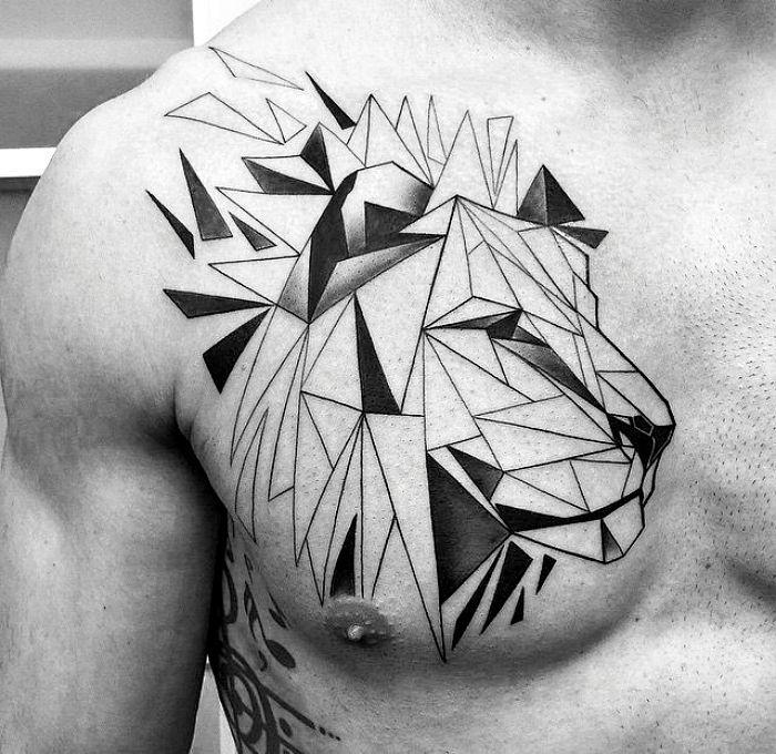 Мужское тату на грудь - лев в геометрии