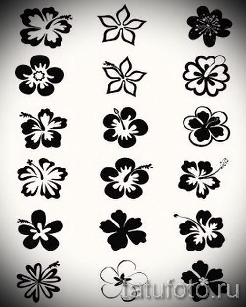 Тату маленьких черных цветов для девушек