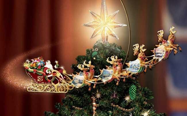 Дед мороз катается на сонях вокруг елки, праздник к нам приходит